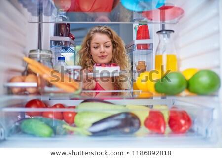 woman taking dessert from refrigerator stock photo © andreypopov
