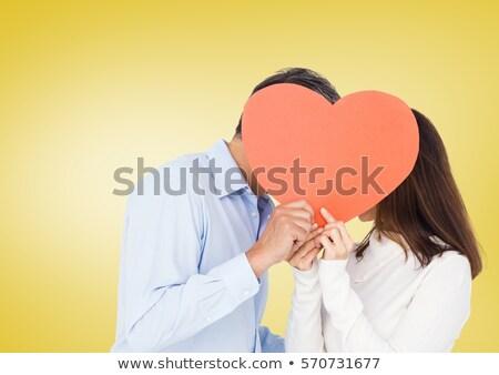 Stock photo: Couple Kissing Behind Heart Shape
