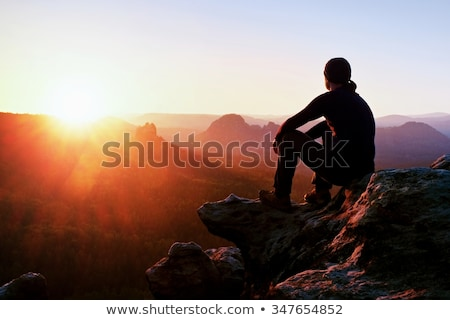 Tourist sitting on a hill and looks at mountain valley Stock photo © Kotenko