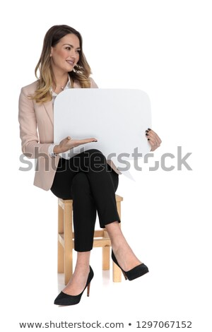 seated businesswoman presents speech bubble and looks to side Stock photo © feedough