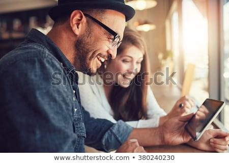 счастливым сидят кофейня портрет Сток-фото © Kzenon