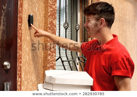 Man Ringing The Door Bell With Pizza Box Stock photo © AndreyPopov