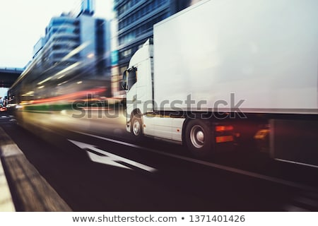 White truck moving fast on the road in a modern city with light effect Stock photo © alphaspirit