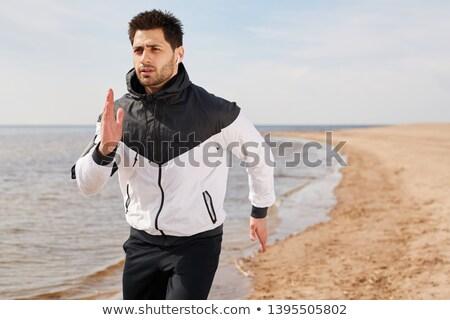 Athlete by waterside Stock photo © pressmaster
