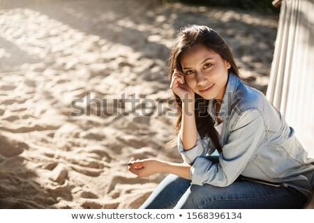 Sand On Woman's Feet Sitting On Hammock At Beach Stock photo © AndreyPopov