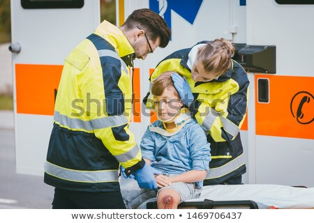 Boy is injured after accident, medics taking care of him Stock photo © Kzenon