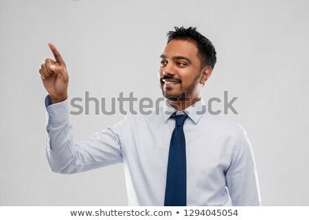 indian businessman touching something invisible stock photo © dolgachov