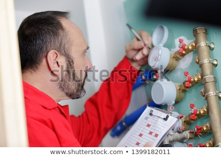 maintenance engineer checking technical data of heating system e Stock photo © Lopolo