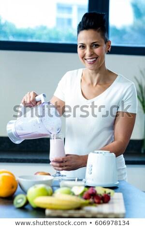 Hamile kadın meyve iki yüzlü ev sağlıklı beslenme Stok fotoğraf © dolgachov