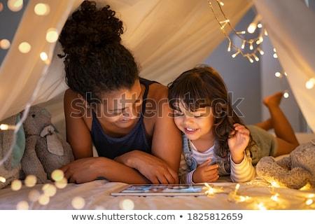 Mutlu kızlar çocuklar çadır konuşma ev Stok fotoğraf © dolgachov