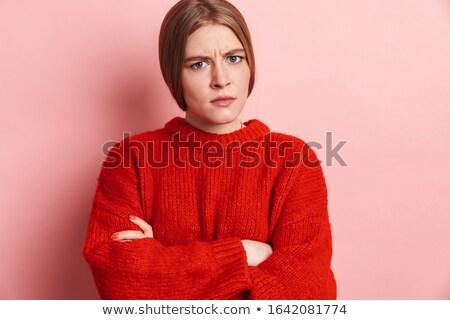 Fotó bosszús szőke nő piros pulóver pózol Stock fotó © deandrobot
