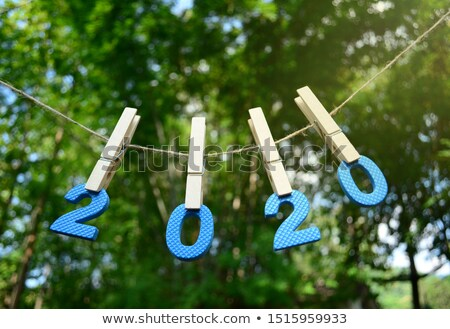 future colorful words hang on rope stock photo © ansonstock