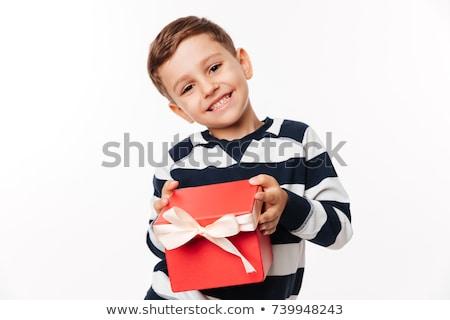 Jongen presenteert weinig glimlachend geïsoleerd Stockfoto © sapegina