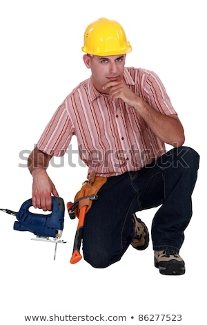 confident worker kneeling with band saw stock photo © photography33