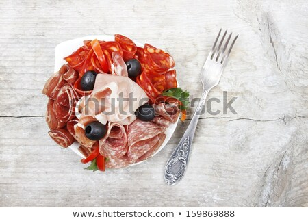 Stock photo: Cracker with Salchichon and olives