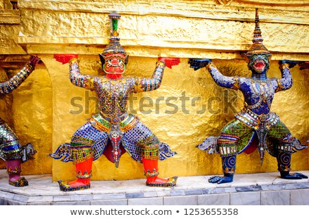 Gold pagoda and guardian statue at Wat Phra Kaew Grand Palace in Stock photo © happydancing