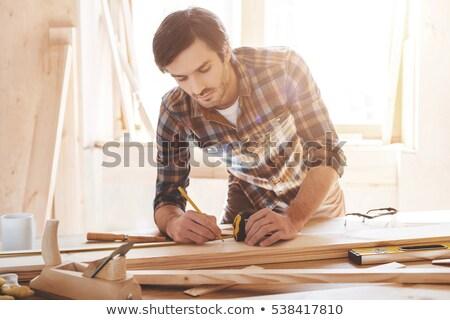 Man measuring wood Stock photo © photography33