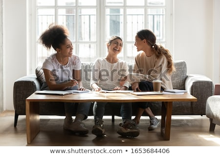 Three male students gathered on the sofa Stock photo © photography33
