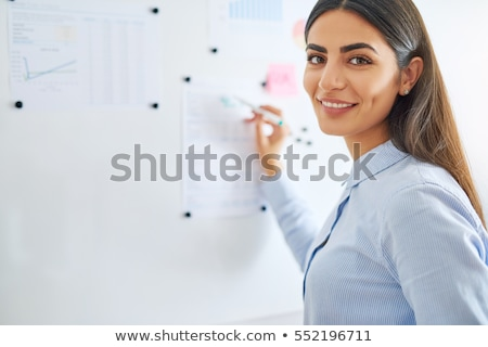 young business woman writing with marker stock photo © feedough