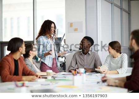 multi ethnic team during a meeting stock photo © ambro