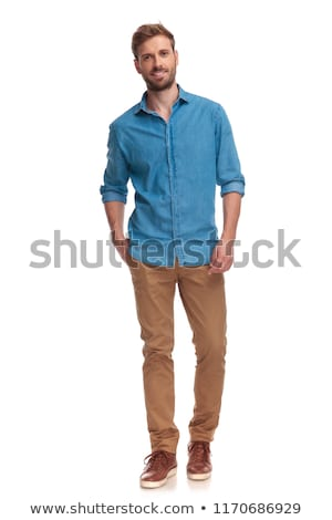 Hombre pie manos jeans bolsillo vista lateral Foto stock © stockyimages