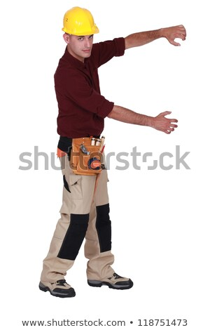 Tradesman framing an invisible object with his arms Stock photo © photography33