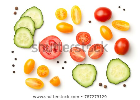 Sliced cherry tomatoes and cucumbers Stock photo © yelenayemchuk