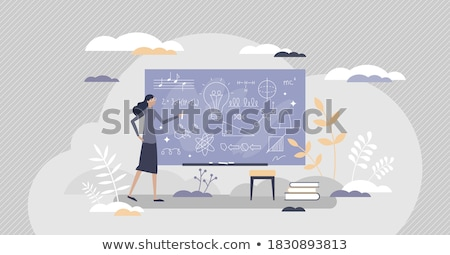 A teacher writing Intelligent Design on a blackboard. Stock photo © latent