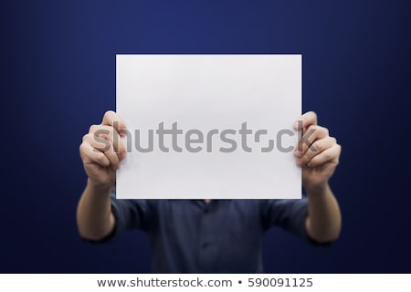young businessman holding blank paper stock photo © nik187