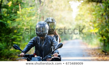 couple on motorcycle helmet stock photo © photography33