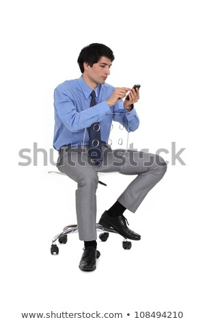 üzletember szék küldés sms üzlet iroda Stock fotó © photography33