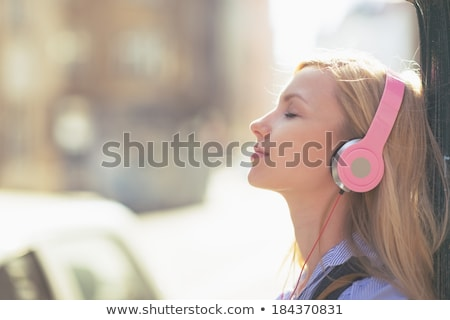 Young woman listening to music with mp3 player Stock photo © photography33