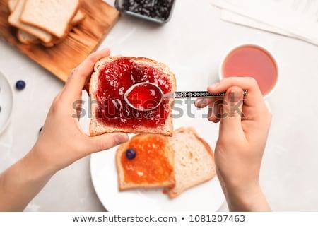 Foto d'archivio: A Woman Eating Jam