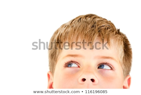 Handsome blond boy looking into the corner. Stock photo © annakazimir