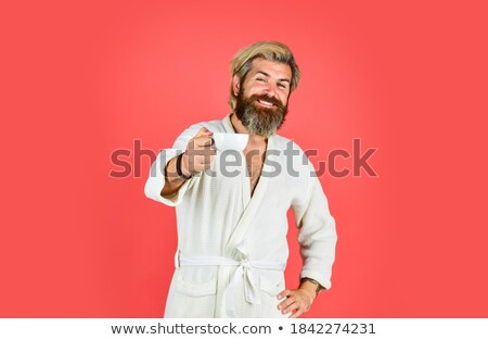 man in dressing gown drinking milk stock photo © photography33