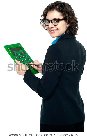 Young corporate lady turning back and smiling Stock photo © stockyimages