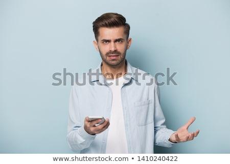 Decepcionado hombre teléfono trabajo teléfono vidrio Foto stock © photography33