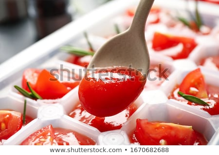 Ice cube and tomato stock photo © Givaga