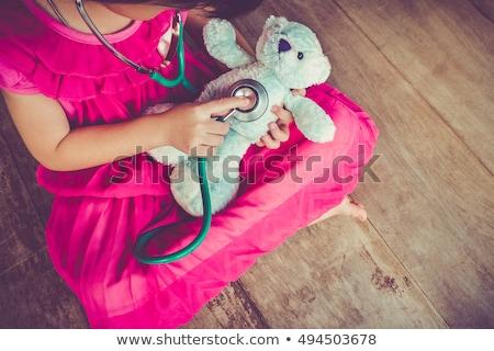 Bambino giocare medico nove anni ragazza bianco Foto d'archivio © jarenwicklund