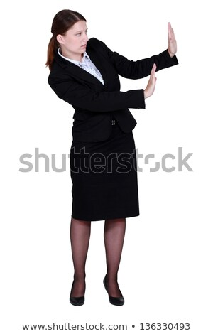 woman in a suit trying to protect herself with her hands Stock photo © photography33
