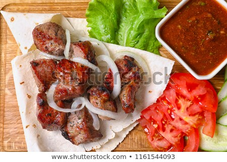 Kebab préparation tomates grill feu dîner Photo stock © ssuaphoto
