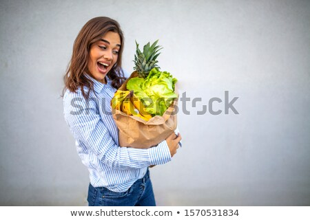 Beautiful woman teeth eating green pepper stock photo © lunamarina