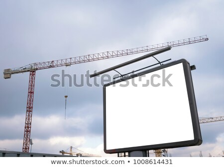 Blank Billboard on the Rising Sun Background. Stock photo © tashatuvango