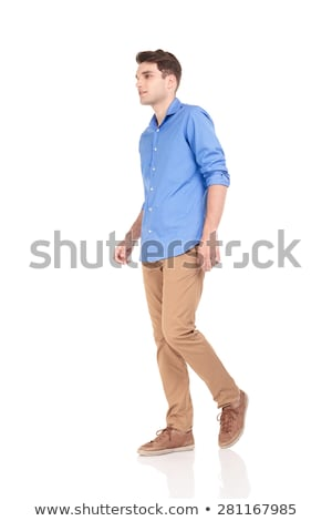 side view of a casual man walking forward and smiling stock photo © feedough