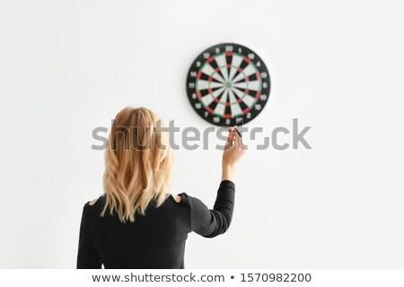 Mulher jogar dardos dardo alvo pub Foto stock © Kzenon
