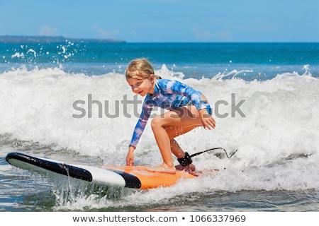 boldog · fiatal · lány · szörfdeszka · tengerpart · portré · mosolyog - stock fotó © ElinaManninen