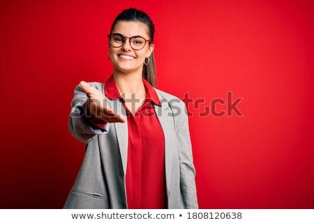 Genç esmer işkadını gözlük imzalamak el sıkışma Stok fotoğraf © sebastiangauert
