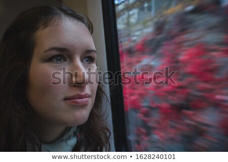 Woman waiting train look at flowers Stock photo © vetdoctor