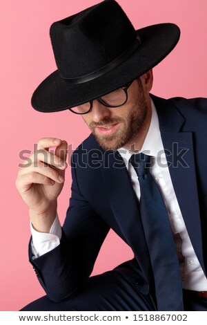 smart young guy hiding his eyes stock photo © stockyimages