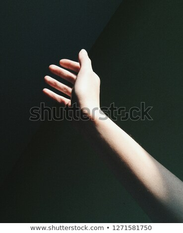 womans hand reaches for the light rays stock photo © adam121